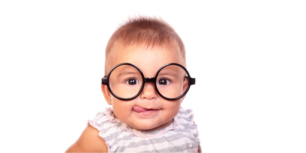 Baby with large glasses on